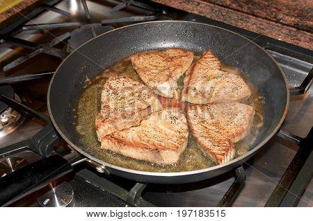 Tuna fish fillets steak in a pan, Costa Rica, Central America