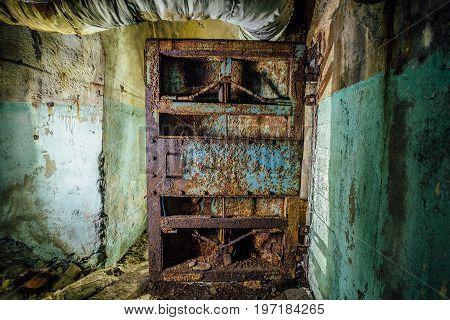 Old rusty steel armored door in abandoned soviet military bunker, Sevastopol