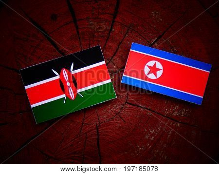 Kenyan Flag With North Korean Flag On A Tree Stump Isolated