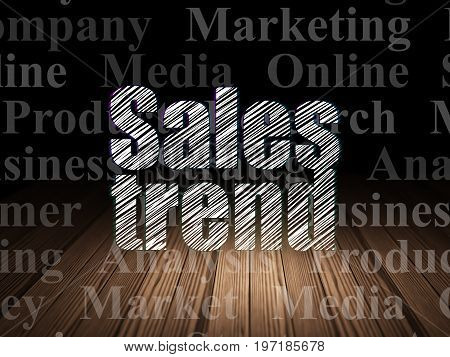 Marketing concept: Glowing text Sales Trend in grunge dark room with Wooden Floor, black background with  Tag Cloud