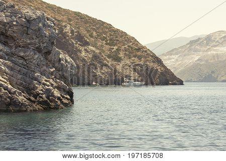 sea, mountain landscape, boat moored near Psira island in Crete, Greece