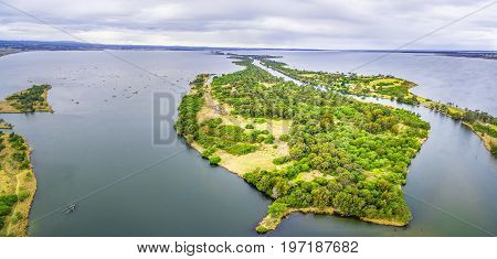 Aerial panoramic view of Silt Jetties Eagle Point Bay and Jones Bay at Gippsland Lakes Reserve Victoria Australia