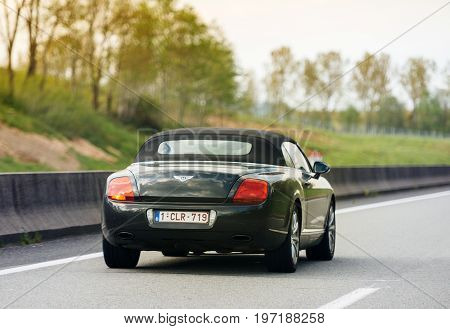 PARIS FRANCE - MAY 7 2017: Luxury Bentley Cabriolet driving fast on French highway