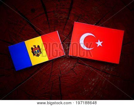 Moldovan Flag With Turkish Flag On A Tree Stump Isolated