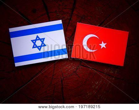 Israeli Flag With Turkish Flag On A Tree Stump Isolated