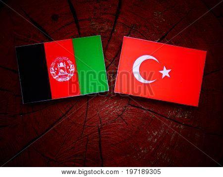 Afghani Flag With Turkish Flag On A Tree Stump Isolated
