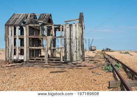 Old fishing boat and shed falling to pieces