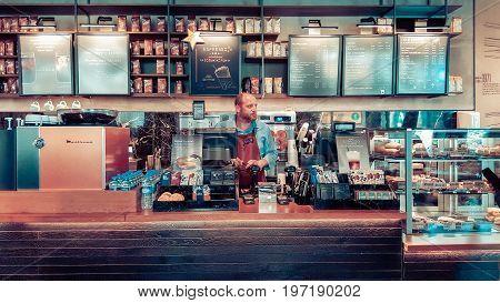 Istanbul, Turkey - June 02, 2017: Barista At Starbucks Coffee Shop In Istanbul.