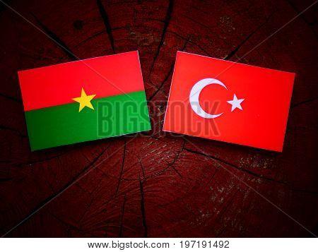 Burkina Faso Flag With Turkish Flag On A Tree Stump Isolated
