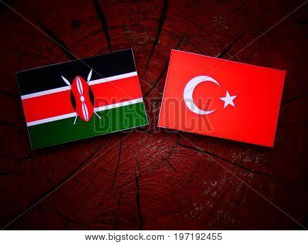 Kenyan Flag With Turkish Flag On A Tree Stump Isolated