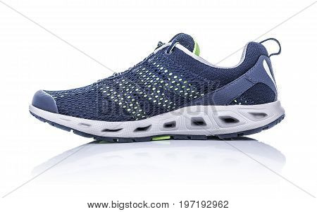 Unbranded modern sneaker isolated on a white background. Blue sneaker.