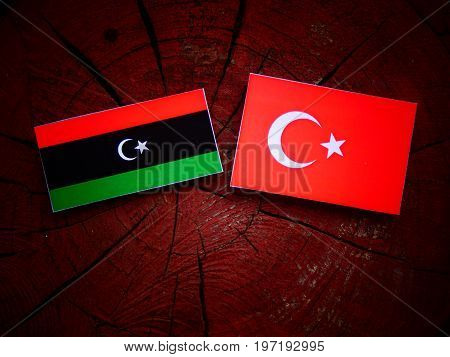 Libyan Flag With Turkish Flag On A Tree Stump Isolated