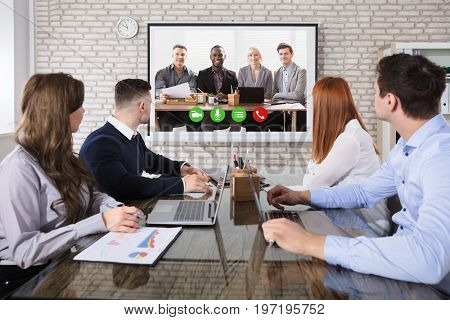Group Of Business People Doing Video Conferencing In Business Meeting At Office