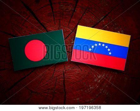 Bangladesh Flag With Venezuelan Flag On A Tree Stump Isolated