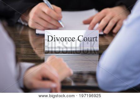 Divorce Court Name Plate On Desk In Courtroom