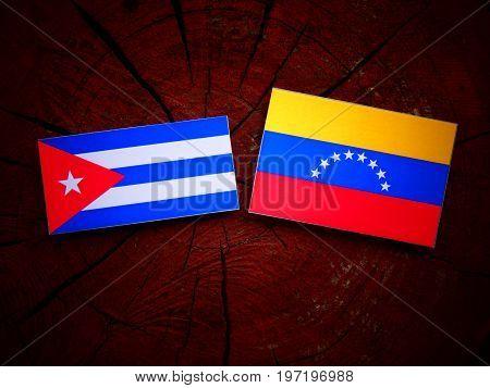 Cuban Flag With Venezuelan Flag On A Tree Stump Isolated