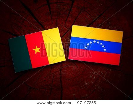 Cameroon Flag With Venezuelan Flag On A Tree Stump Isolated