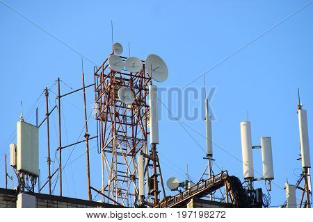 Telecommunication Base Stations Network Repeaters On The Roof Of The Building. The Cellular Communic