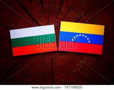 Bulgarian Flag With Venezuelan Flag On A Tree Stump Isolated