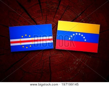Cape Verde Flag With Venezuelan Flag On A Tree Stump Isolated