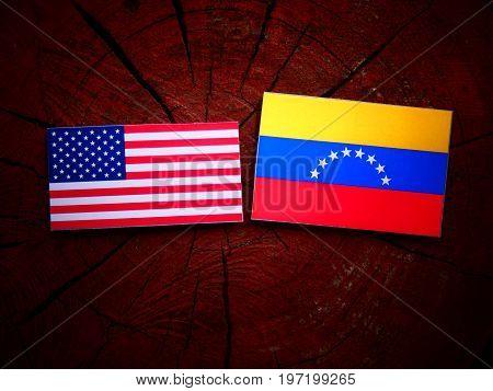 Usa Flag With Venezuelan Flag On A Tree Stump Isolated