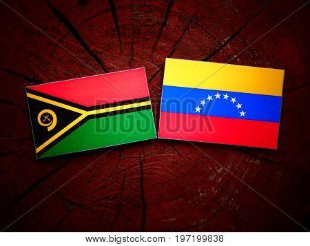 Vanuatu Flag With Venezuelan Flag On A Tree Stump Isolated