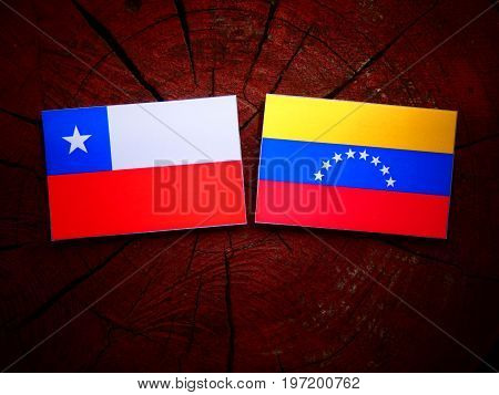 Chilean Flag With Venezuelan Flag On A Tree Stump Isolated