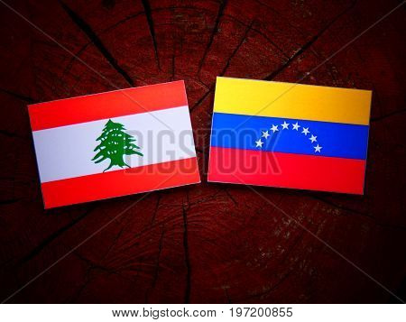 Lebanese Flag With Venezuelan Flag On A Tree Stump Isolated