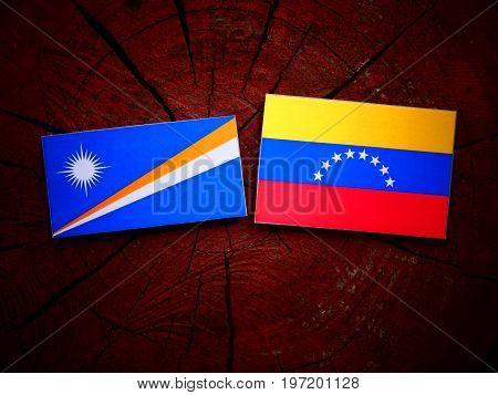 Marshall Islands Flag With Venezuelan Flag On A Tree Stump Isolated