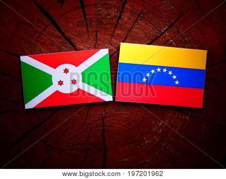 Burundi Flag With Venezuelan Flag On A Tree Stump Isolated