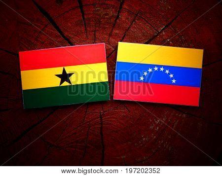 Ghanaian Flag With Venezuelan Flag On A Tree Stump Isolated
