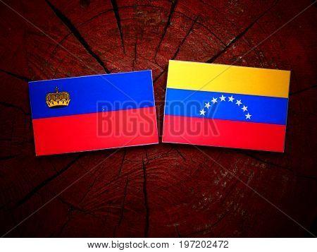 Liechtenstein Flag With Venezuelan Flag On A Tree Stump Isolated