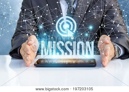 Businessman Shows The Word Mission .