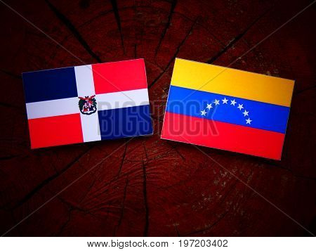 Dominican Republic Flag With Venezuelan Flag On A Tree Stump Isolated