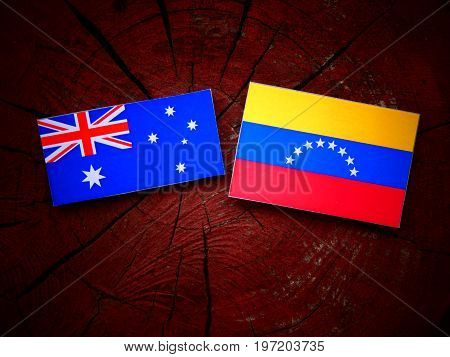 Australian Flag With Venezuelan Flag On A Tree Stump Isolated