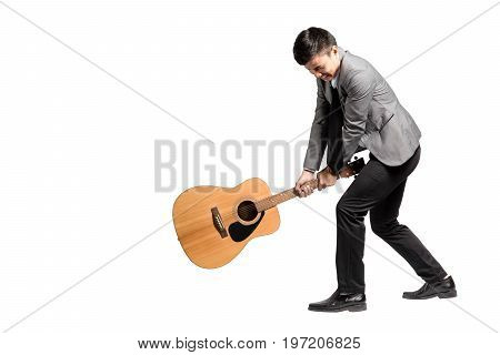 Portrait Of A Young Business Man Smashing His Guitar. Isolated On White Background With Copy Space A