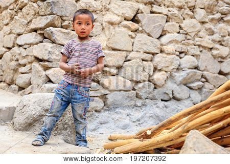 Leh, Ladakh, India, July 14, 2016: Portrait of a local boy on a street in Leh, Ladakh, India