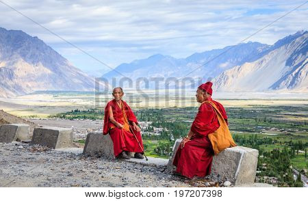 Nubra Valley, Ladakh, India, July 14, 2016: two monks near Diskit Monastery overlooking Nubra Valley in Ladakh region of Kashmir, India