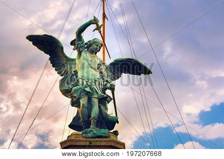 Bronze statue of Michael the Archangel, the top statue of Castle of the Holy Angel or Castle Saint Angel in Rome, Italy