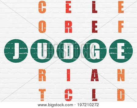 Law concept: Painted green word Judge in solving Crossword Puzzle