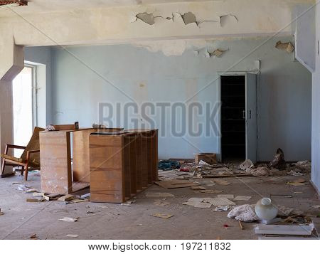 Old Furniture Scattered Around The Room. Interior Details Inside The Destroyed House Of Culture. The