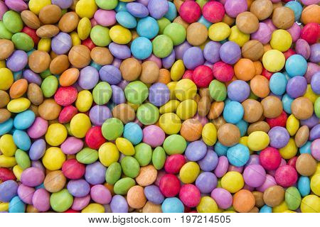 many colorful round sweet candies texture background