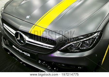 Sankt-Petersburg Russia July 21 2017: Front view of a Mercedes Benz C 63s coupe 2017. Front Headlight. Dark Matt colour .Car exterior details. Photo Taken at Royal Auto Show July 21