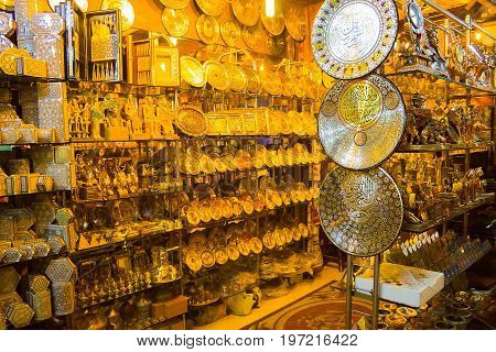 Sharm El Sheikh, Egypt - April 13, 2017: Alabaster vase and statuettes in abstract Egyptian souvenir shop. Selective focus