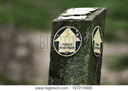 In England, public footpaths can cut across public land, but users must stay on the paths. This marker directs the way through a large estate in the rural county of Suffolk