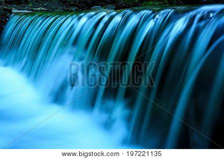 nice waterfall on mountain river