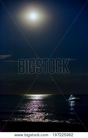 Night scene over sea with moon over water