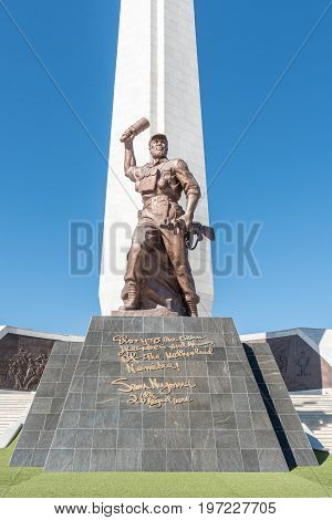 WINDHOEK NAMIBIA - JUNE 16 2017: An 8 meter high bronze sculpture of The Unknown Soldier at Heroes Acre an official war memorial of the Republic of Namibia to the south of Windhoek