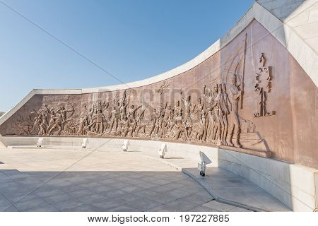 WINDHOEK NAMIBIA - JUNE 16 2017: A bronze mural at Heroes Acre depicting the struggle of indigenous Namibians at Heroes Acre to the south of Windhoek