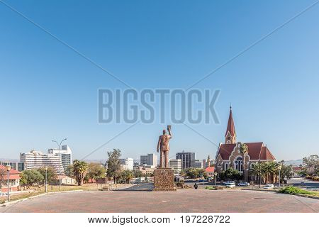 WINDHOEK NAMIBIA - JUNE 17 2017: A view of Windhoek as seen from the Independence Memorial. The statue of Dr. Sam Nujoma and the Christuskirche are visible
